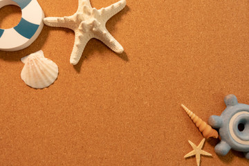 Background image of summer: shells, star fish, anchor and sun glasses (center text space)