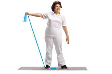 Elderly woman working out with a rubber band