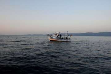 The Wider Image: As stocks deplete, Greek fishermen send boats to scrap