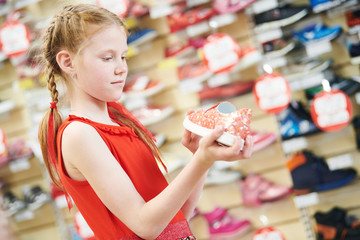 season sale. Little girl shopping walking shoe