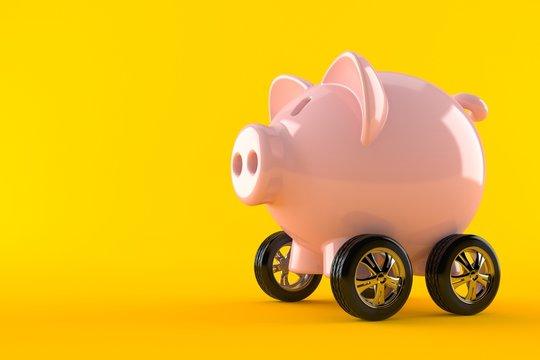 Piggy bank with car wheels
