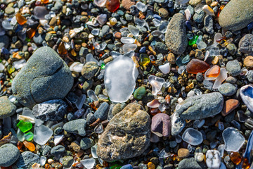 Glass beach sand with large white piece