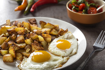 Eggs and Fries with small pieces of fat pork meat, onion and garlic