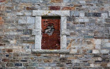 Brick wall in stone window