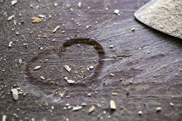 heart on the picture on a wooden dusty background, the concept of love repair