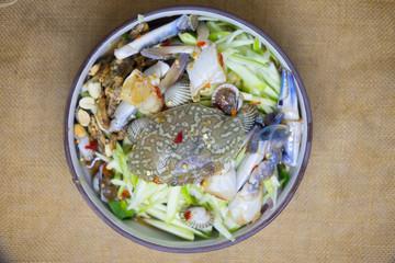 Spicy mango salad with blue crab
