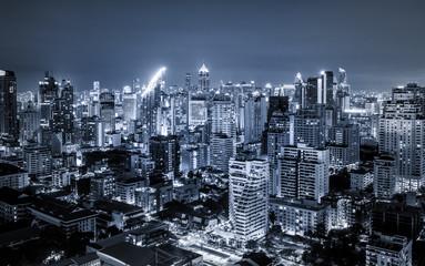 scenic of dark night urban cityscape lighting up metropolis
