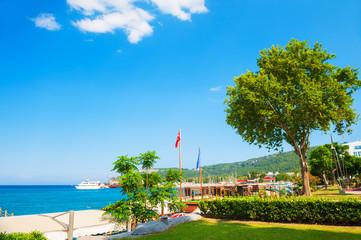 Beautiful sea promenade with green trees in Kemer, Turkey.