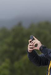 Human hand holding smartphone