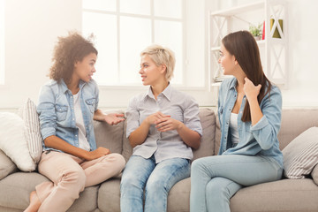 Female friends chatting at home