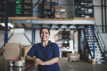 Portrait of female working in packing warehouse