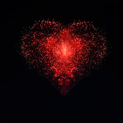 Fireworks are in the sky in the shape of a heart