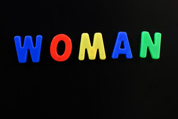 English letters in black background are the words women