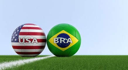 Brazil vs. USA Soccer Match - Soccer balls in Brazil and USA national colors on a soccer field. Copy space on the right side - 3D Rendering