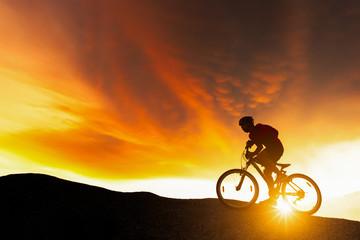 Extreme mountain bike sport athlete man riding outdoors lifestyle trail.