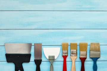 Different lengths putty knife for façade and paintbrushes.