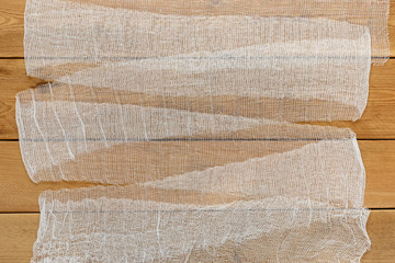 Wood background texture with the bandage.