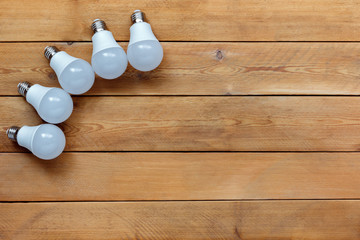 LED lamp on a wooden background.