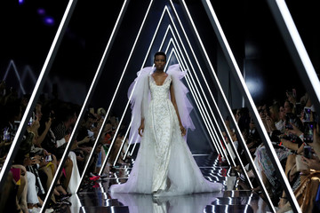 A model presents a creation by designers Tamara Ralph and Michael Russo as part of their Haute Couture Fall/Winter 2018/2019 collection show for fashion house Ralph & Russo in Paris