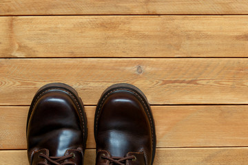 Male shoes on a wooden background.