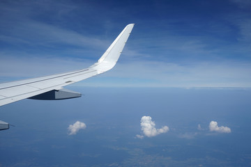 Three clouds and airplane wing.
