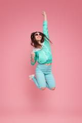 Cheerful woman jumping high