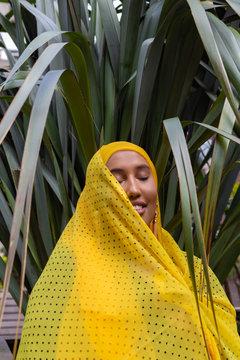 Woman wearing a yellow hijab
