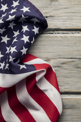 American stars and stripes flag on a white wooden plank background