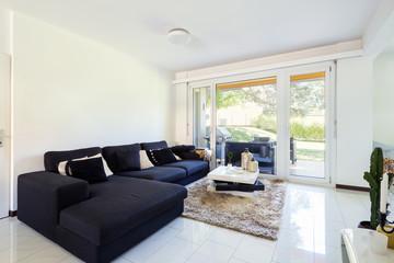 Modern living room with large dark sofa