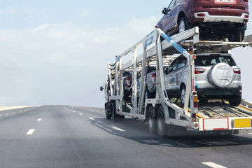 Trailer transport cars on the highway.Truck on highway road container, transportation concept.,import,export logistic industrial Transporting Land transport on the expressway.soft focus of cars