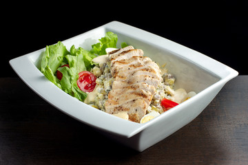Fresh salad with chicken breast.