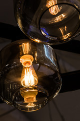 glass ceiling with light bulb Edison close-up