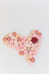 Numerous medicines Medications in the form of tablets. Colored pills on a white background.