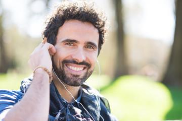 Man listening music outdoors
