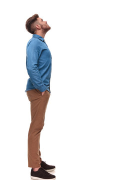 side view of relaxed casual man looking up