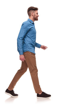 side view of handsome casual man walking