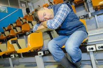Man asleep in auditorium