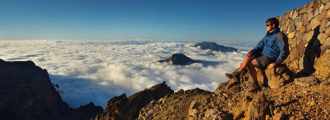 Resting man watching a landscape above the crater Caldera de Taburiente, Island of La Palma, Canary Islands, Spain