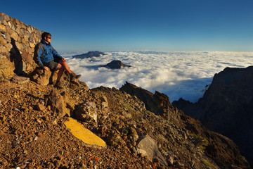 Resting man watching a landscape above the crater Caldera de Taburiente, Island of La Palma, Canary Islands, Spain