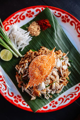 Crab Pad Thai served with lime, scallions, bean sprouts. crushed peanut and chili powder.