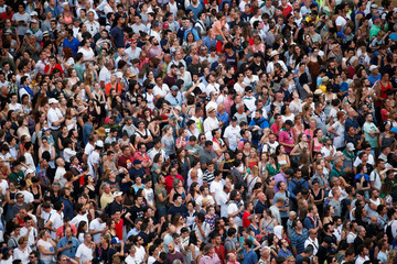 Spectators stand in Piazza del Campo as they wait for the start of the Palio of Siena