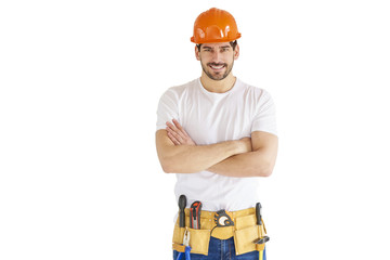 Handyman portrait. Young construction worker wearing hard hat and tool belt against white isolated background