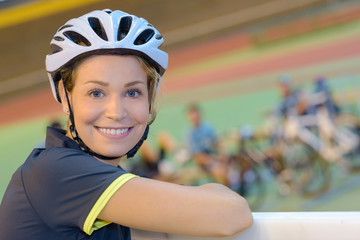 young woman on the bicycle wearing on the helmet