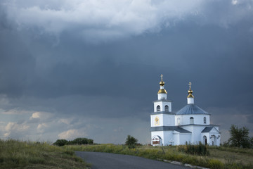 Orthodox temple on a dramatic sky background