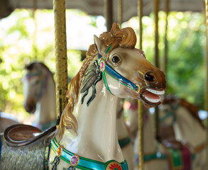 carousel horse is ready to give a fun ride