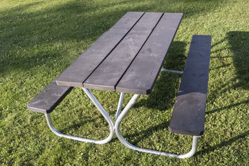 Picnic Table At A Park With Green Grass
