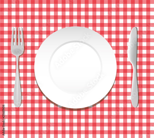 plate fork knife cutlery on red checkered tablecloth copy space