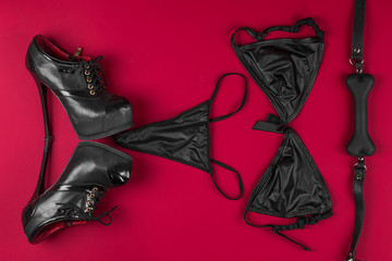 black underwear for fetish on a red background