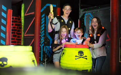 Kids with parents during lasertag game