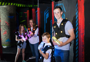 Father and son playing laser tag